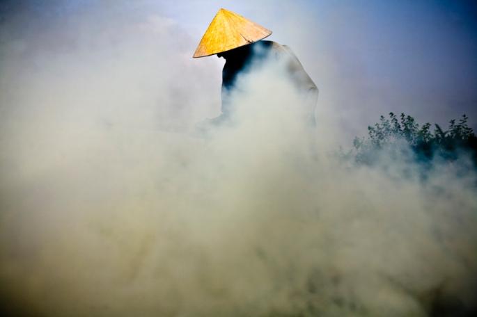 A farmer in Hanoi, Vietnam, photographed by Aaron Joel Santos.