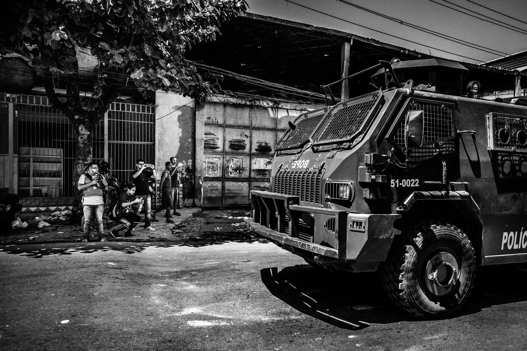 Members of a Brazilian citizen journalism collective document police activity in a Rio de Janeiro favela. Sebastián Liste, Spain, 2015, Noor.