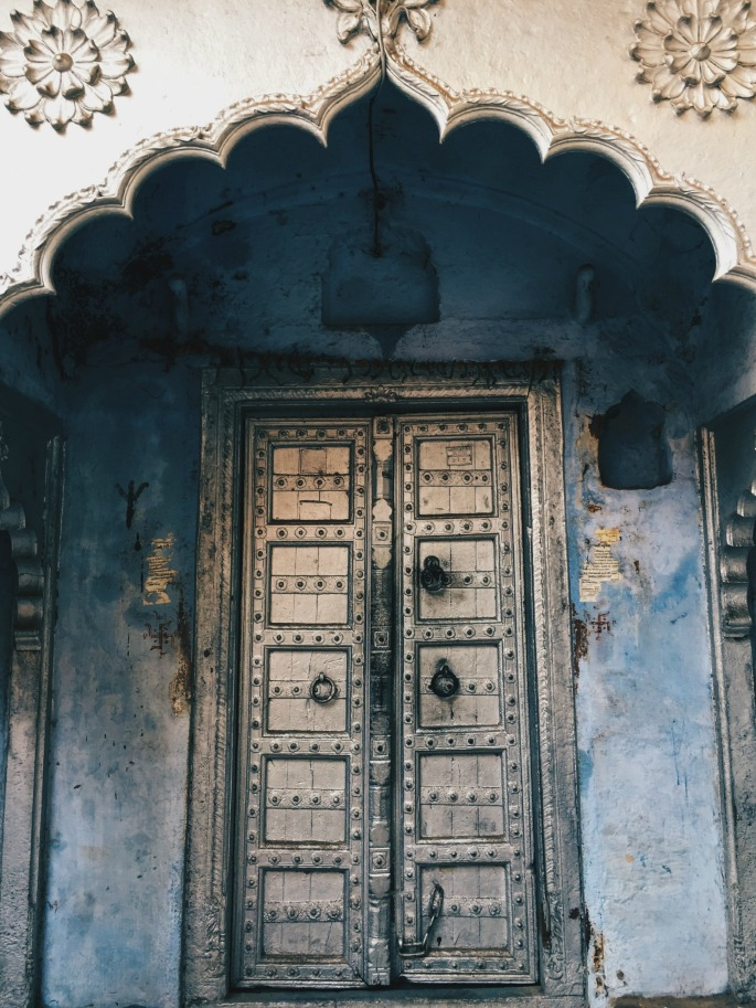 Most doors in rural India are freshly painted regularly with unique color combinations. Blue is used often, especially in hot regions, as a respite from the heat.