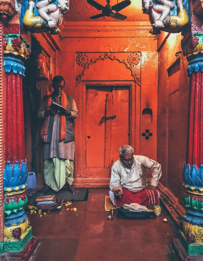 Two priests complete the door frame in a temple in Varanasi.