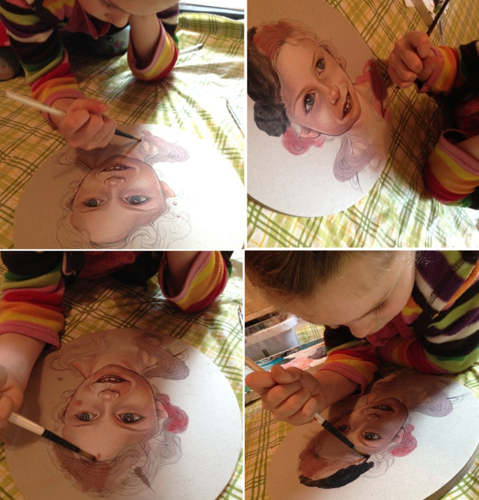 Drawing and painting with her daughter, Myla.