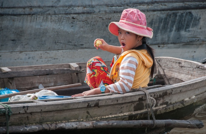 young girl in a rowboat