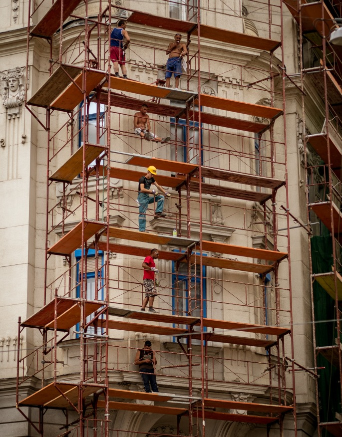 men on scaffolded building