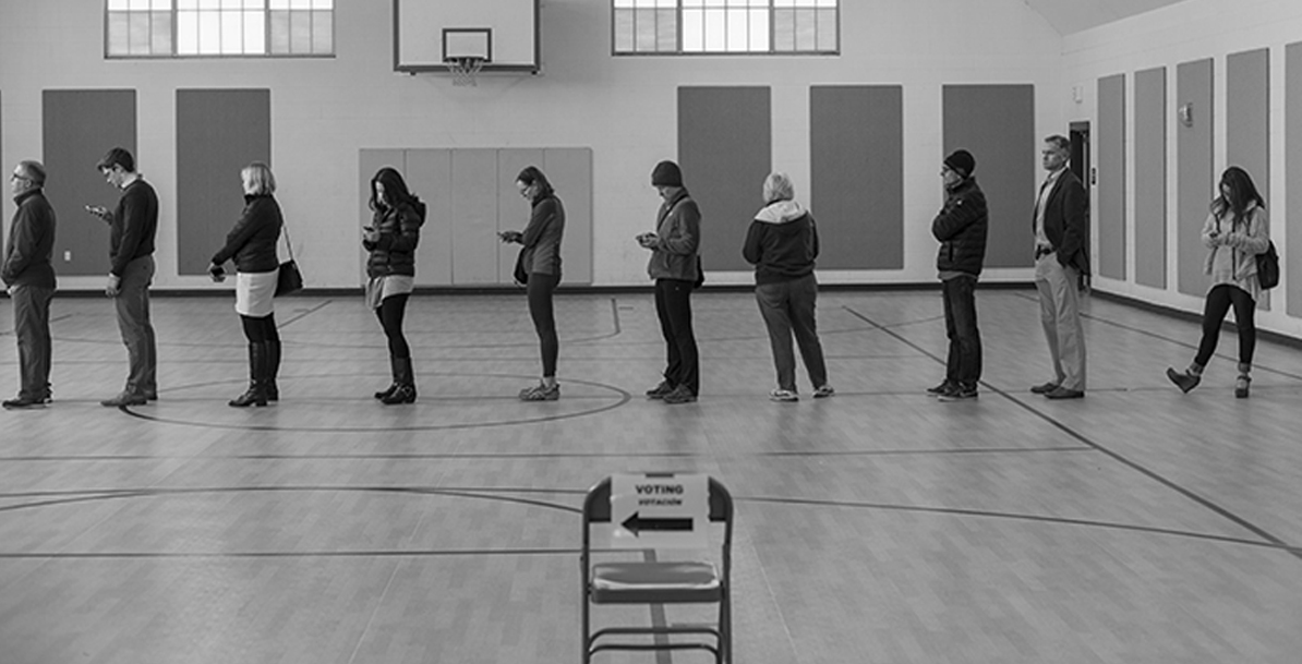 people on line at a polling place
