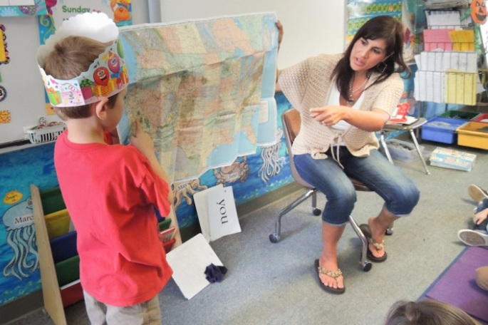 Teacher Lisa Carpentier introduces map-reading skills to her students.