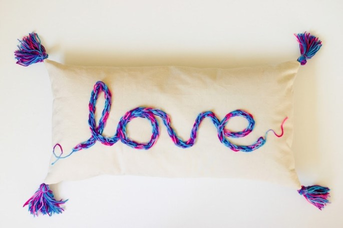 "A tasseled ""love pillow"" from Flax & Twine."