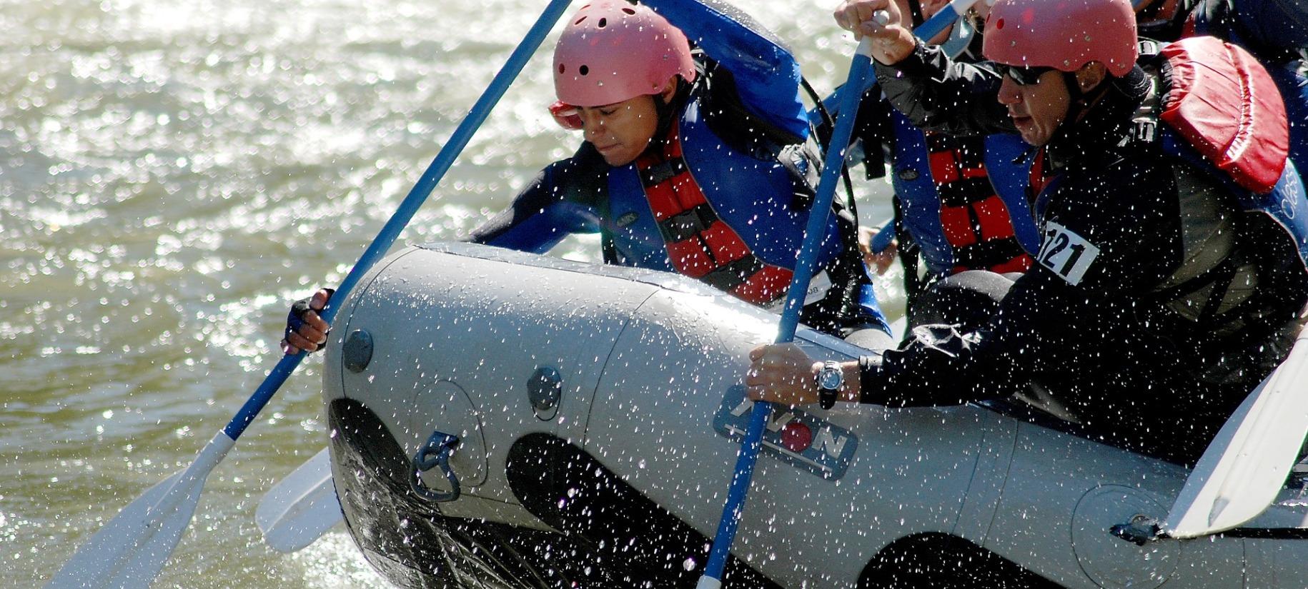 team of people rafting